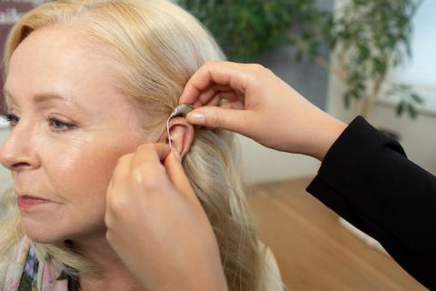 Broadmead Hearing Audiologist Fitting A Hearing Aid