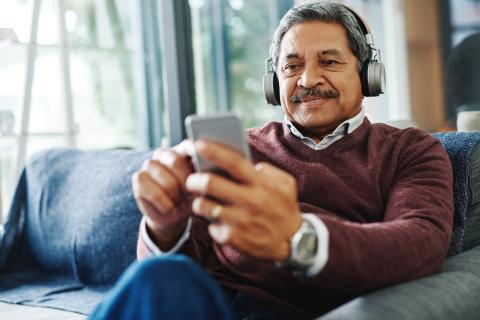 Man wearing headphones for Broadmead Hearing online hearing check