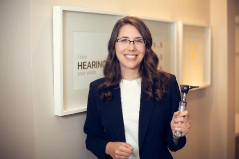 Audiologist holding an otoscope